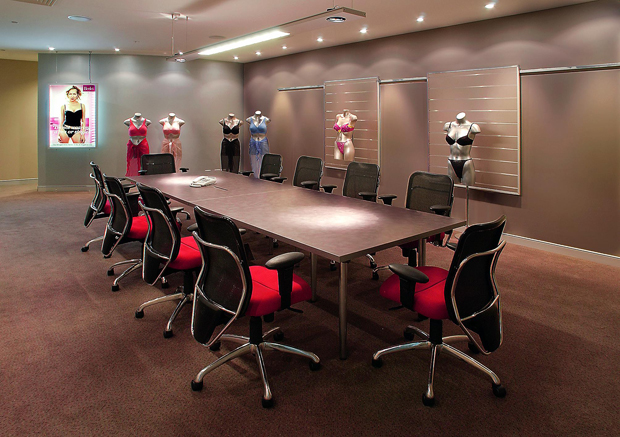 One of three inter-connecting Presentation Rooms at the Berlei Group.  Purpose built conference tables are easily dismantled and moved aside, to open up the space for larger conferencing facilities