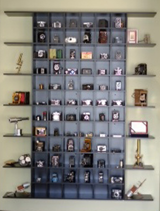 Purpose designed display cabinet for photographic collection.  This cabinet is designed to dismantle into two separate sections for ease of relocation should our clients wish to do so.  (Image to be replaced with clearer version)